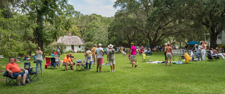 Photograph by Lori Key of Key Photo showing guests enjoying the Moon Shadow over Hopsewee eclipse viewing party August 21, 2017
