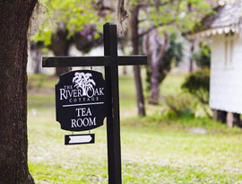 Sign greeting visitors to the River Oak Cottage Tea Room at Hopsewee. Photo by Mick Schulte.