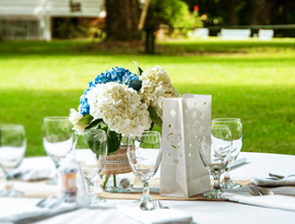 View of a floral place setting featuring for an outdoor wedding reception at Hopsewee Plantation. Photo by Alan Sherlock.