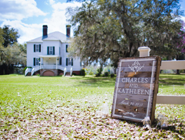 Rustic sign with bride and groom names greets wedding ceremony guests at Hopsewee Plantation. Photo by Mick Schulte.